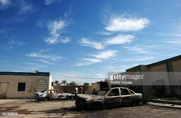 Burnt out cars lie at the Mustafa Shiite Mosque on March 27 2006 northeast of Baghdad Iraq 20 Iraqis were killed following a last night US backed...
