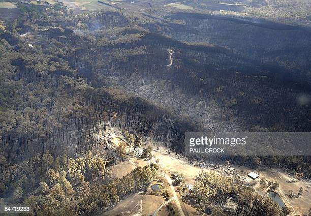 Burnt out houses and sheds lie in ruins after a wildfire raced up from farmland below near Bunyip in the latrobe Valley some 100km east of Melbourne...