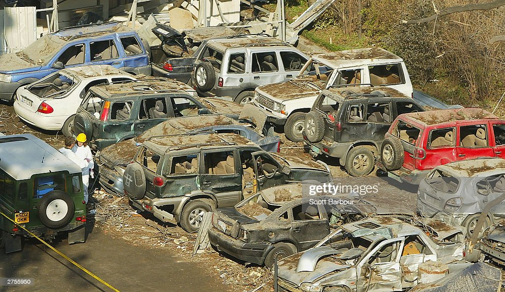 Burnt out vehicles are seen inside of the damaged British Consulate courtyard November 23, 2003 in Istanbul, Turkey. Bomb attacks on the British consulate and the HSBC bank headquarters killed 27 people and left hundreds injured.