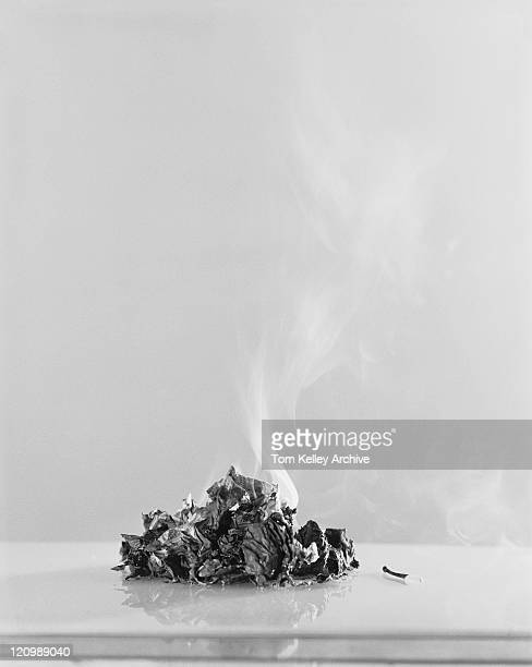 Burnt paper against white background
