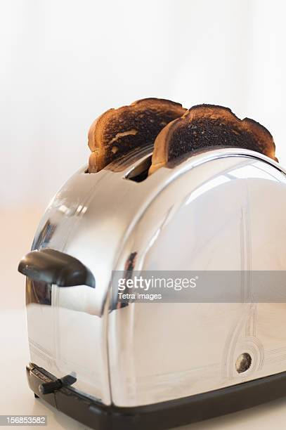 Burnt toasts in toaster