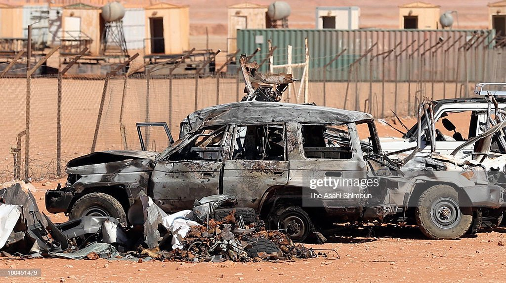 A burnt vehicle remains on a roadside between residential area and the gas plant on January 31, 2013 in In Amenas, Algeria. Thirty-seven foreign hostages including 10 Japanese and 29 Islamic militants died.