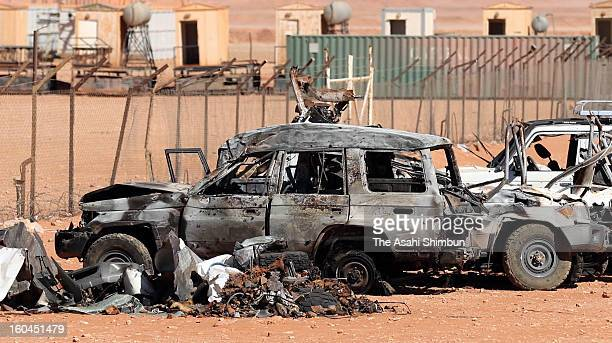 A burnt vehicle remains on a roadside between residential area and the gas plant on January 31 2013 in In Amenas Algeria Thirtyseven foreign hostages...