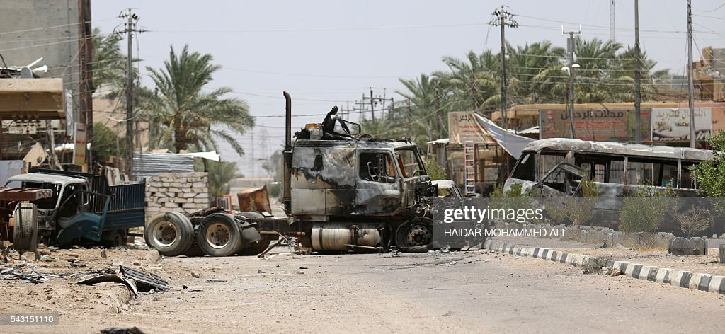 Burnt vehicles are seen in Fallujah, 50 kilometres (30 miles) from the Iraqi capital Baghdad, after Iraqi forces retook the embattled city from the Islamic State group on June 26, 2016. Iraqi Prime Minister Haider al-Abadi urged all Iraqis to celebrate the recapture of Fallujah by the security forces and vowed the national flag would be raised in Mosul soon. While the battle has been won, Iraq still faces a major humanitarian crisis in its aftermath, with tens of thousands of people who fled the fighting desperately in need of assistance in the searing summer heat. ALI
