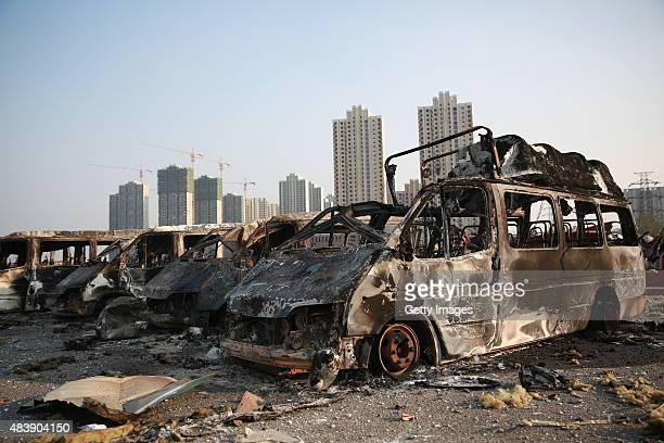 Burnt vehicles are seen in Tianjin's warehouse explosion on August 13 2015 in Tianjin China The death toll from Wednesday warehouse explosions in...