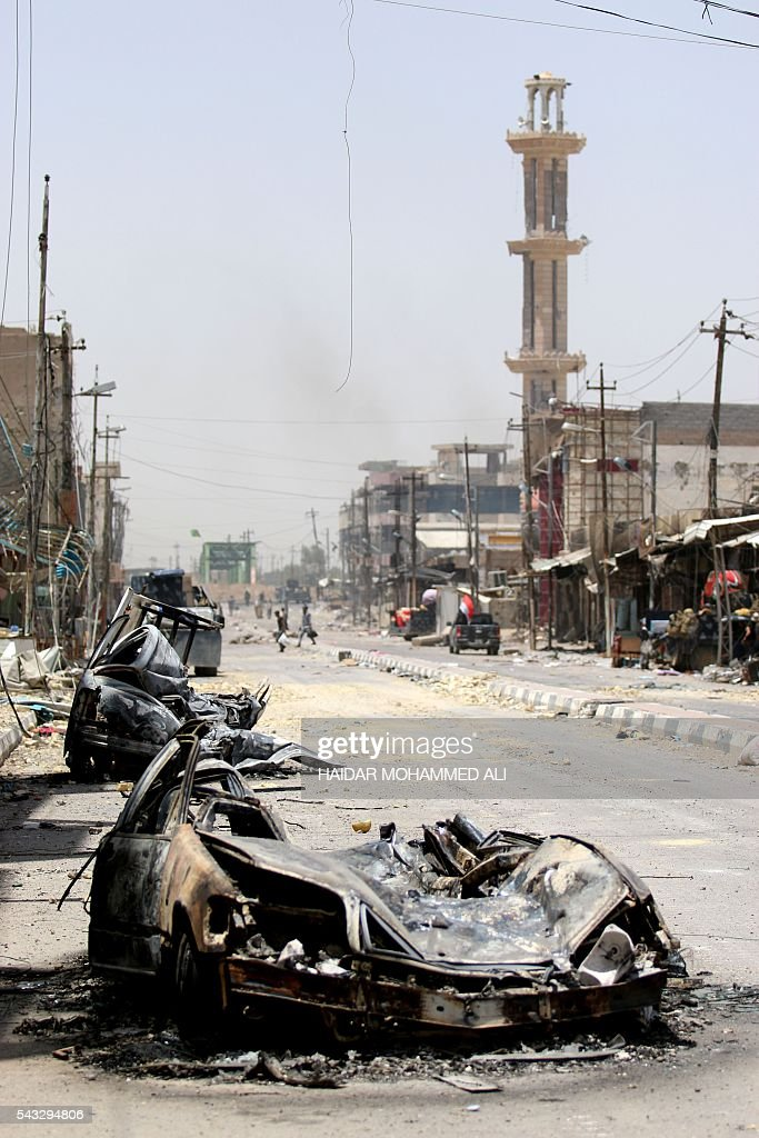 Burnt vehicles are seen on a street on June 27, 2016 in western Fallujah, 50 kilometres (30 miles) from the Iraqi capital Baghdad, after Iraqi government forces retook the embattled city from the Islamic State group. Iraqi forces took the Islamic State group's last positions in the city of Fallujah on June 26, 2016, establishing full control over one of the jihadists' most emblematic bastions after a month-long operation. ALI