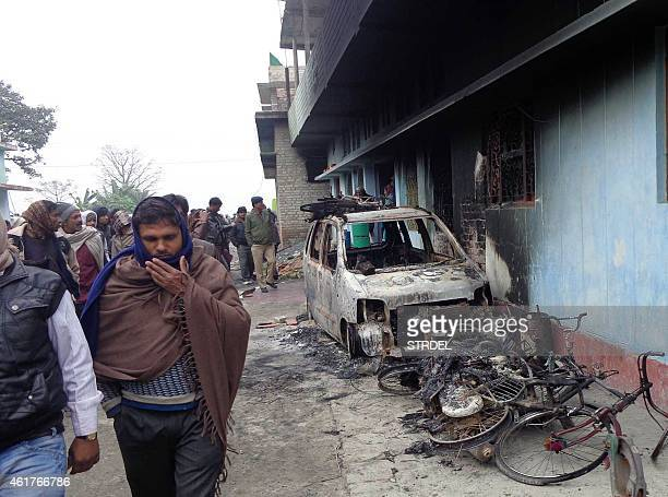 Burnt wreckage of vehicles set on fire by a rioting mob are seen in front of a charred house at Sareya village in Muzaffarpur district of India's...