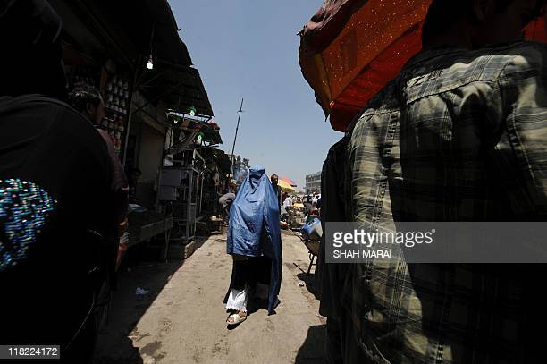 A burqaclad Afghan women makes her way at a bazaar in Kabul on May 23 2011 An Afghan Taliban spokesman said it was 'not possible at all' that their...