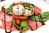 Burratta with italian prosciutto and tomato with a balsamic vinaigrette