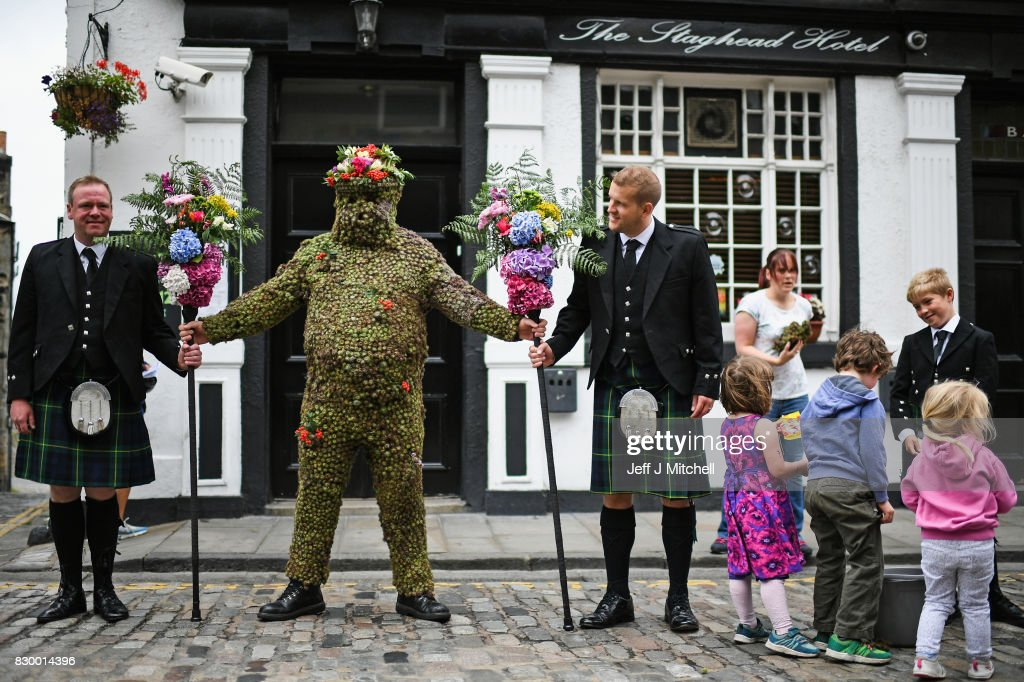 Burryman Andrew Taylor meets residents as he parades through the town encased in burrs on August 11, 2017 in South Queensferry, Scotland. The parade takes place on the second Friday of August each year and although the exact meaning of this tradition has been lost through the years though it is thought to have begun in the Seventeenth century. The tradition is believed to bring good luck to the towns people if they give him whisky offered through a straw or a donation of money.