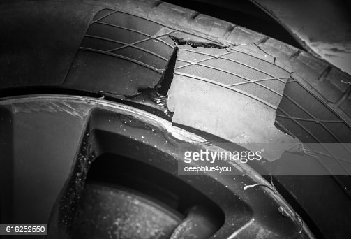 Burst car tire after accident : Foto de stock