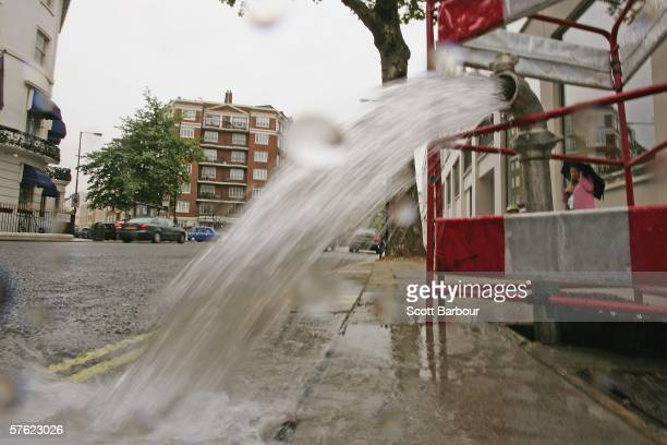 A burst pipe spews water onto a street near Lancaster Gate on May 16 2006 in London England One of the driest periods in 70 years has caused...