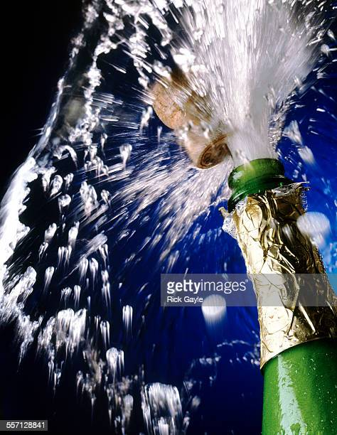 Bursting champagne bottle