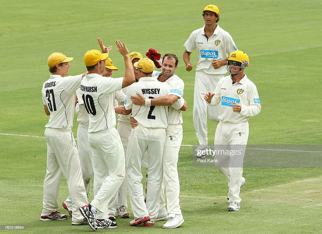 Burt Cockley of the Warriors celebrates with <a gi-track='captionPersonalityLinkClicked' href=/galleries/search?phrase=Michael+Hussey&family=editorial&specificpeople=171690 ng-click='$event.stopPropagation()'>Michael Hussey</a> after dismissing Mark Cosgrove of the Tigers during day two of the Sheffield Shield match between the Western Australia Warriors and the Tasmania Tigers at WACA on February 22, 2013 in Perth, Australia.