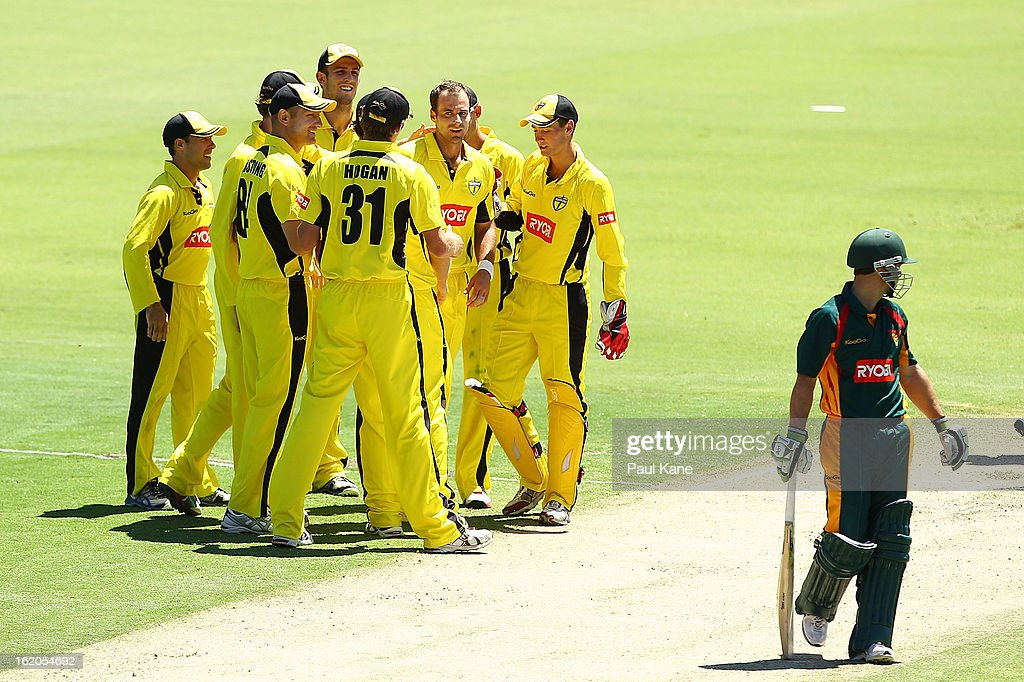 Burt Cockley of the Warriors is congratulated by team mates after dismissing Jon Wells of the Tigers during the Ryobi One Day Cup match between the Western Australia Warriors and the Tasmanian Tigers at the WACA on February 19, 2013 in Perth, Australia.