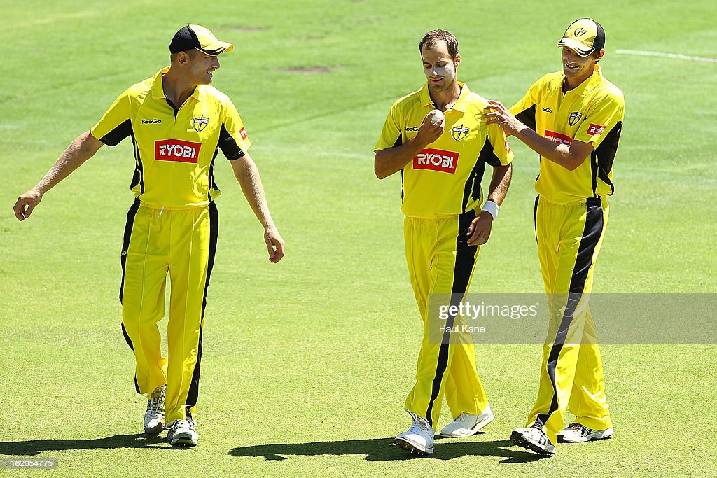 Burt Cockley of the Warriors receives some encouragement from Tim Armstrong (L) and Michael Hogan (R) during the Ryobi One Day Cup match between the Western Australia Warriors and the Tasmanian Tigers at the WACA on February 19, 2013 in Perth, Australia.