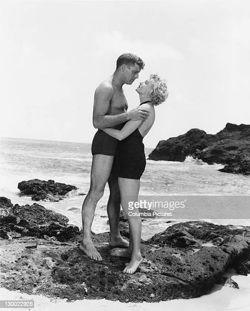 Burt Lancaster and Deborah Kerr in a scene from 'From Here to Eternity' Halona Cove Oahu Hawaii 1953 The film was directed by Fred Zinnemann for...