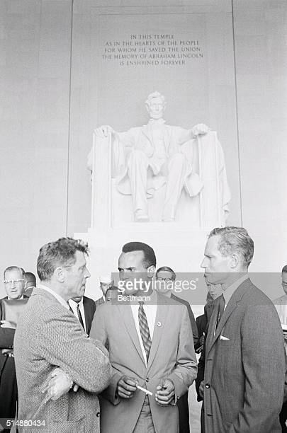 Burt Lancaster Harry Belafonte and Charleton Heston stand inside the Lincoln Memorial during the March on Washington for Jobs and Freedom in 1963