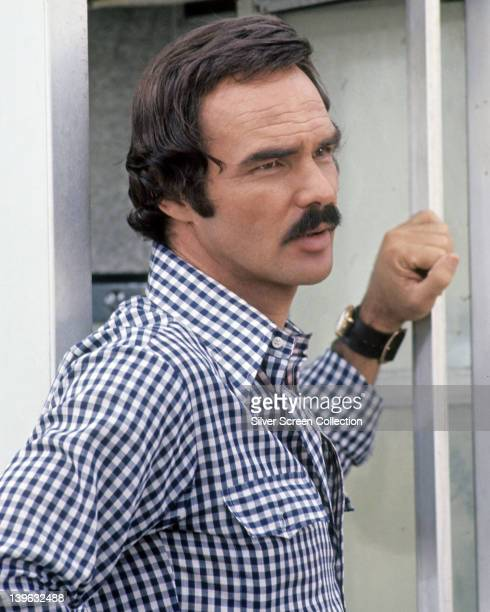 Burt Reynolds US actor wearing a blue and white check shirt circa 1980