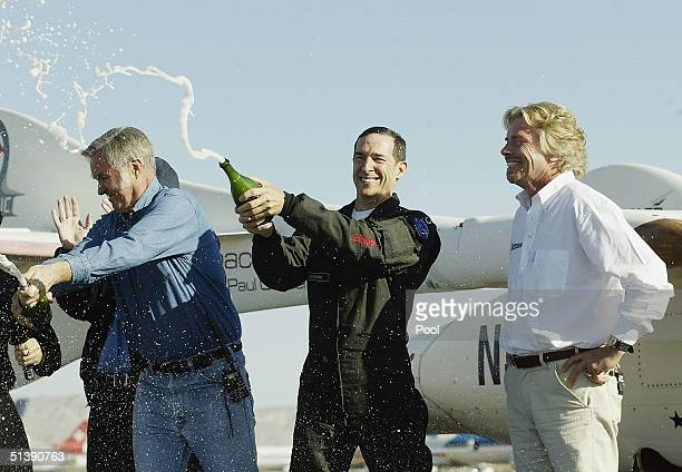 Burt Rutan pilot Brian Binnie and Sir Richard Branson celebrate with champagne after a successfull mission of SpaceShipOne's second voyage in a week...