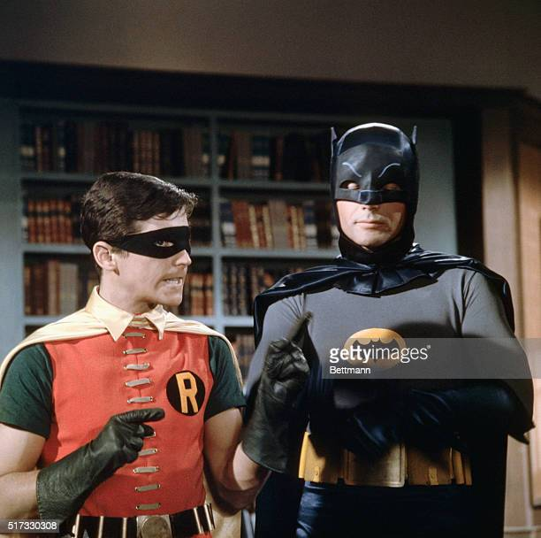 Burt Ward as Robin and Adam West as Batman discuss their next move against Gotham City's supervillains on the set of the Batman television show |...