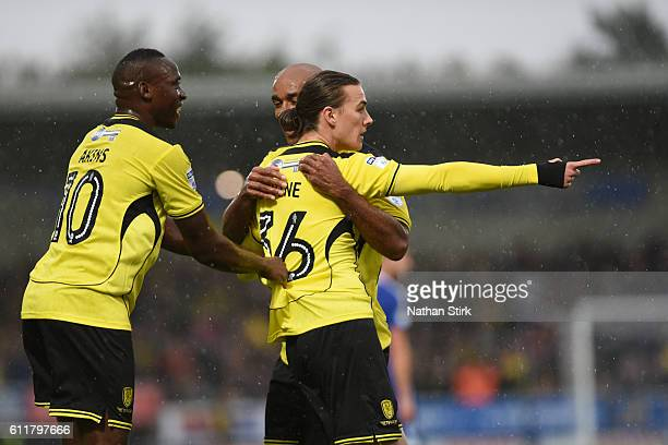 Burton Albion celebrate after Jackson Irvine scored the opener during the Sky Bet Championship match between Burton Albion and Cardiff City at...