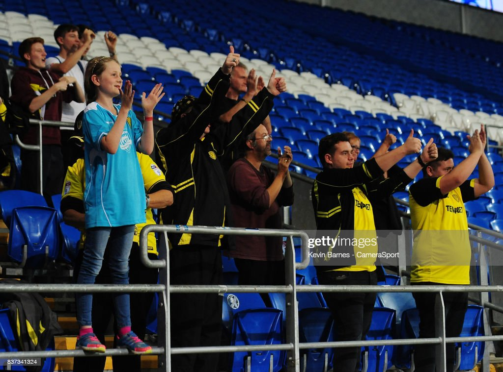 Burton Albion fans celebrate their sides win during the Carabao Cup Second Round match between Cardiff City and Burton Albion at Cardiff City Stadium on August 22, 2017 in Cardiff, Wales.