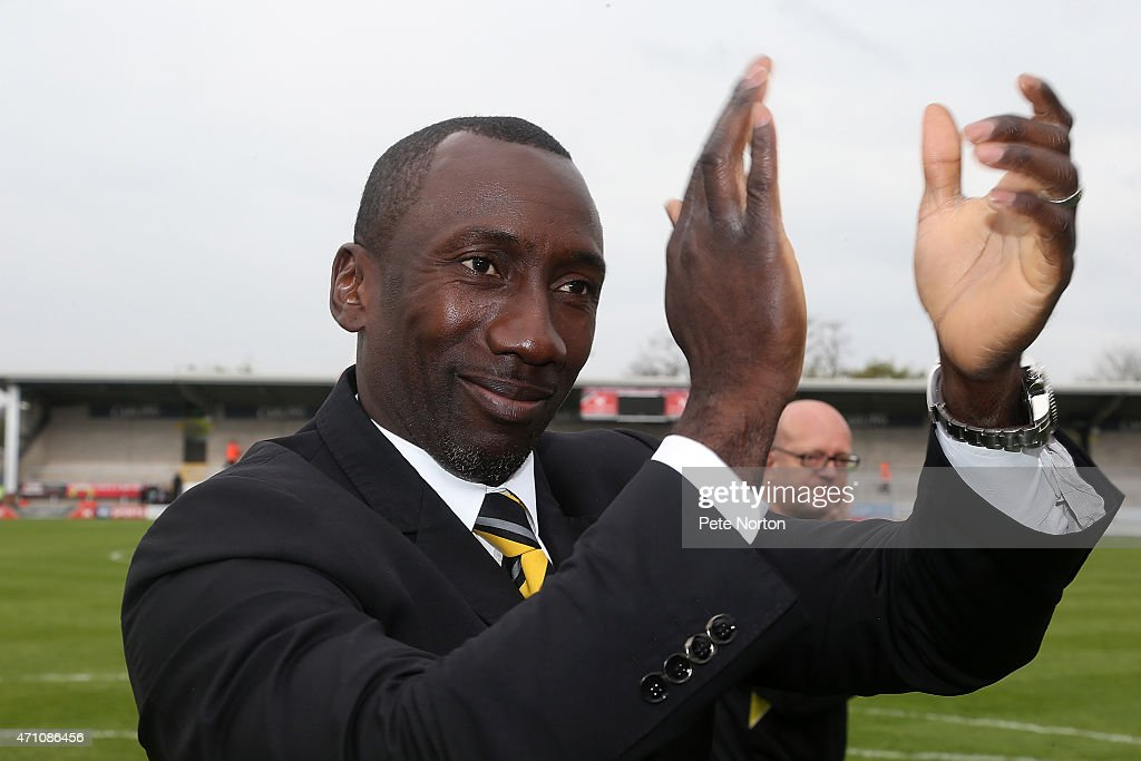 Burton Albion manager Jimmy Floyd Hasselbaink salutes the crowd on a lap of honoiur at the end of the Sky Bet League Two match between Burton Albion and Northampton Town at Pirelli Stadium on April 25, 2015 in Burton-upon-Trent, England.
