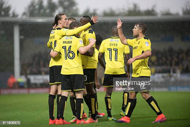 Burton Albion players celebrate after Jackson Irvine scores the opener during the Sky Bet Championship match between Burton Albion and Cardiff City...