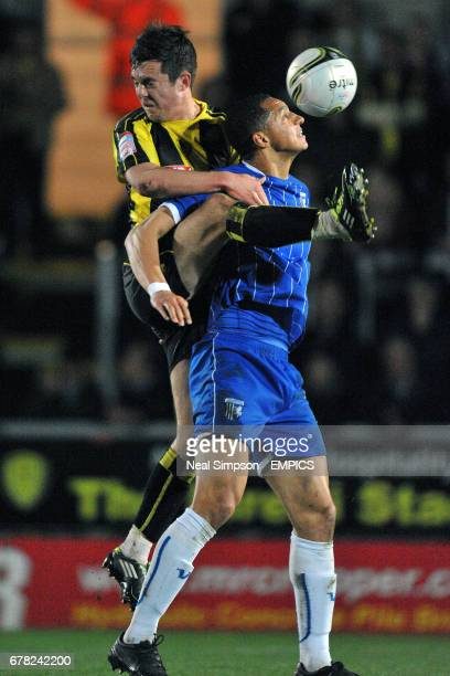 Burton Albion's Jack Dyer and Gillingham's Lewis Montrose fight for possession of the ball