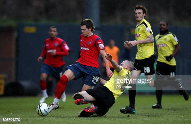 Burton Albion's John McGrath tackles Shrewsbury Town's Tom Bradshaw battle for the ball during the npower League Two match at the Pirelli Stadium...