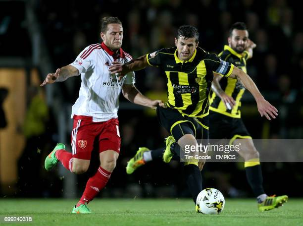 Burton Albion's John Mousinho and Sheffield United's Billy Sharp battle for the ball