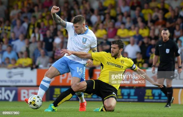 Burton Albion's John Mousinho tackles Sheffield Wednesday's Gary Hooper