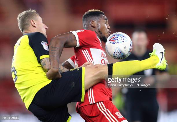 Burton Albion's Kyle McFadzean and Middlesbrough's Britt Assombalonga battle for the ball during the Sky Bet Championship match at the Riverside...