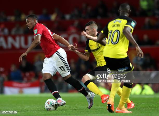 Burton Albion's Matthew Lund pulls back on Manchester United's Anthony Martial during the Carabao Cup Third Round match at Old Trafford Manchester