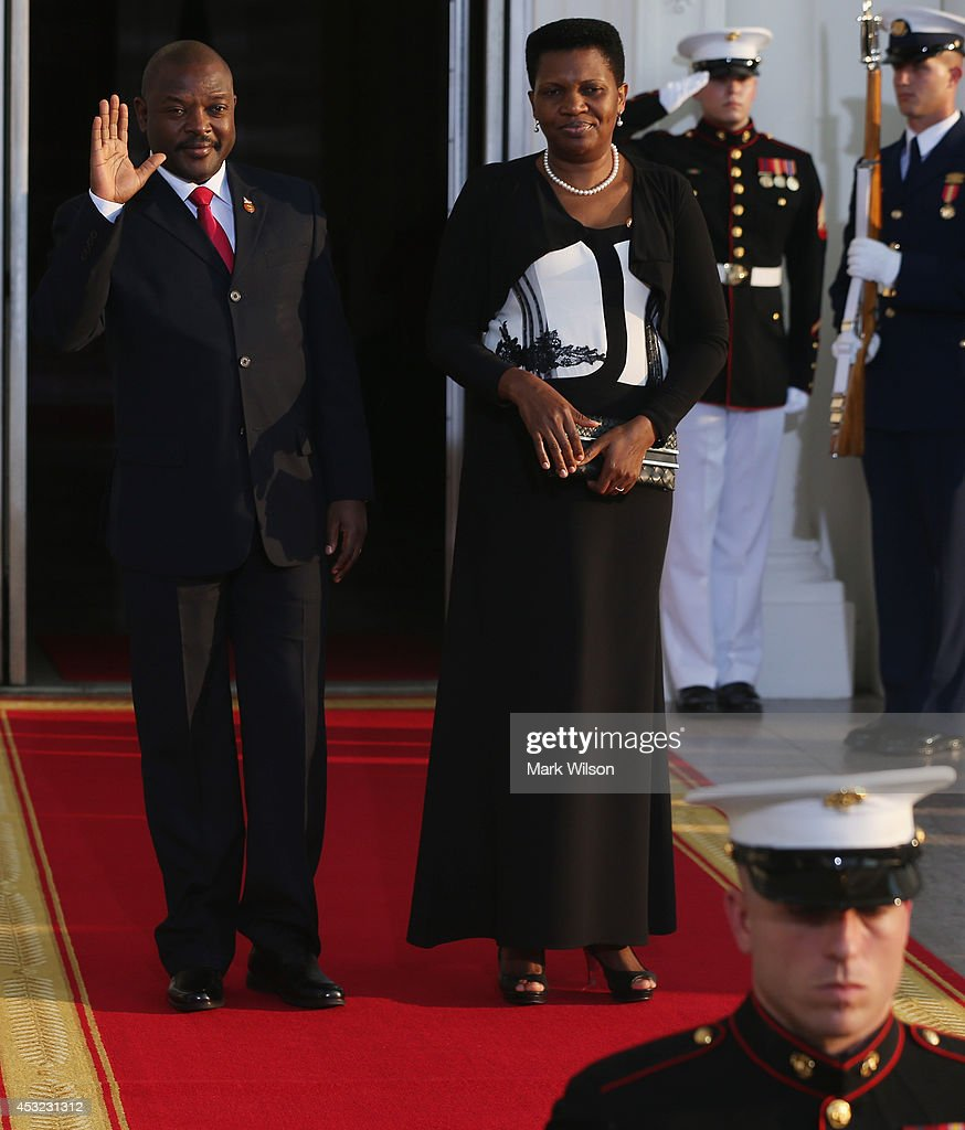Burundi President <a gi-track='captionPersonalityLinkClicked' href=/galleries/search?phrase=Pierre+Nkurunziza&family=editorial&specificpeople=563215 ng-click='$event.stopPropagation()'>Pierre Nkurunziza</a> and spouse Denise Bucumi arrive at the North Portico of the White House for a State Dinner on the occasion of the U.S. Africa Leaders Summit, August 5, 2014 in Washington, DC. African leaders are attending a three-day-long summit in Washington to strengthen ties between the United States and African nations.