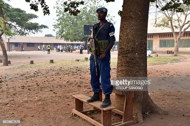 Burundi United Nations peacekeeper keeps watch outside a polling station on December 30 2015 as people go to the polls to take part in the country's...