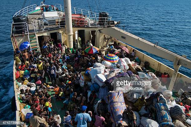 Burundian refugees are transported aboard the MV Liemba passenger cargo on May 21 2015 in the fishing village of Kagunga UNHCR is transporting...