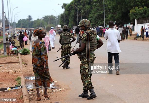 A Burundian soldier of the Africanled International Support Mission to the Central African Republic patrols in the streets of the PK5 district of...