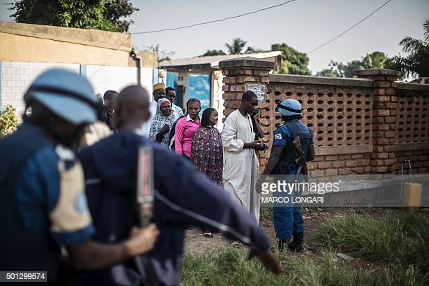 Burundian soldier of the UN peacekeeping force MINUSCA contingent uses a metal detector at the entrance of a polling station in the flashpoint PK5...