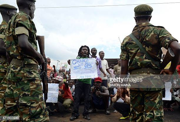 Burundian soldiers contain demonstrators in Musaga on the outskirts of Bujumbura on April 29 during a protest against the President's bid for a third...