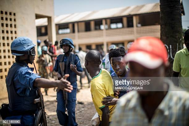 Burundian soldiers from the MINUSCA the United Nations mission in Central African Republic direct civilians to cover as heavy gunfire is directed...
