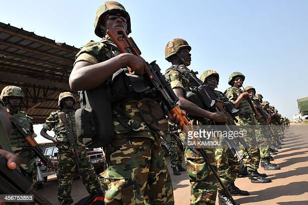 Burundian soldiers stand in rows after arriving at the airport in Bangui on December 15 2013 to join the African Union and French efforts to restore...