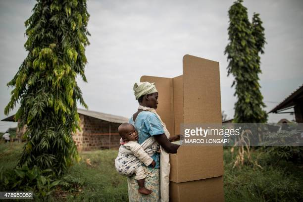 A Burundian woman votes in a polling station in the Kinama neighborhood in Bujumbura on June 29 2015 Voting in Burundi's controversial elections...