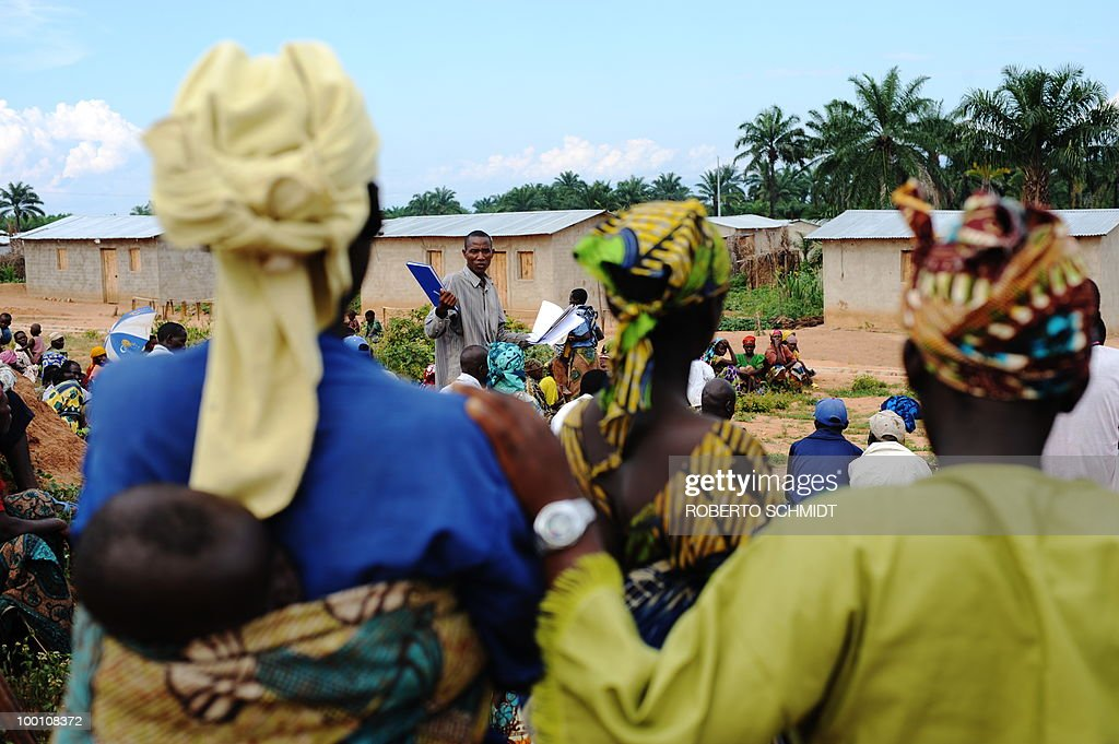 AUSSEILL -- Burundian women listen to a fellow villager after they gathered for a community meeting in a field near a cluster of homes donated by the United Nations and known as a 'Peace Village' n...