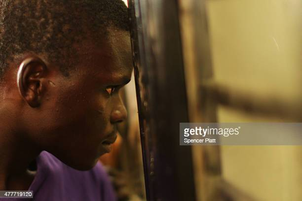 Burundians converge on a government administration building as they attempt to get their passports and travel documents as they wish to leave the...