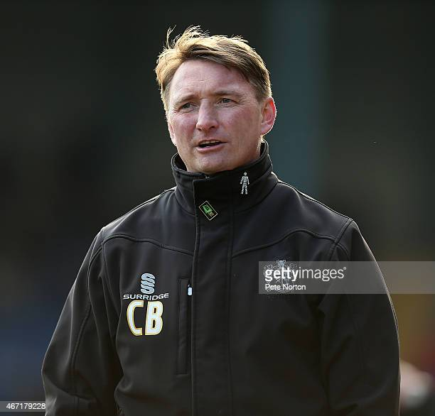 Bury assistant manager Chris Brass looks on during the Sky Bet League Two match between Bury and Northampton Town at The JD Stadium on March 21 2015...