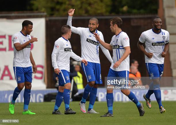 Bury FC players celebrate after Leon Clarke scores his side's first goal