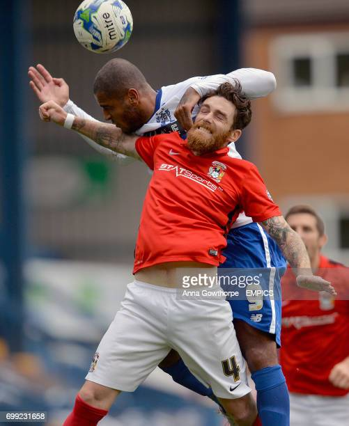 Bury FC's Leon Clarke and Coventry City's Romain Vincelot in action