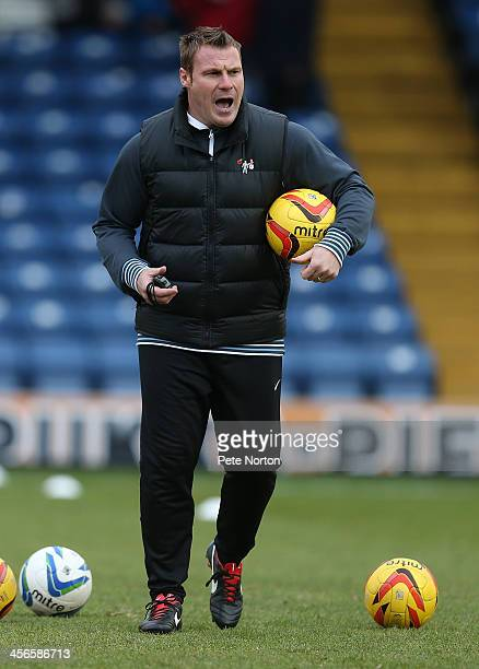 Bury manager David Flitcroft gives instructions as the players warm up prior to the Sky Bet League Two match between Bury and Northampton Town at...